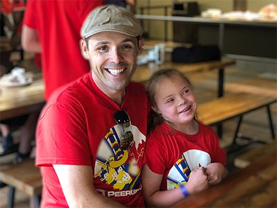 Man holding his child at company-organized Wonderland trip