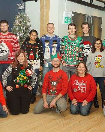 PEER Group employees in Christmas sweaters