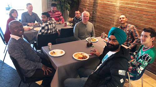 PEER Group employees having lunch together