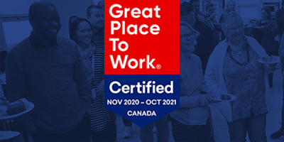 Great Place to Work certification over PEER Group photo of smiling employees