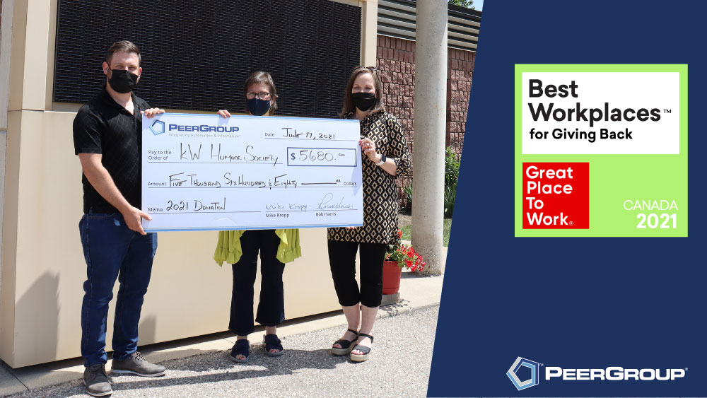PEER Group donating to KW Humane Society